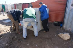 The benches are attached, by community workers