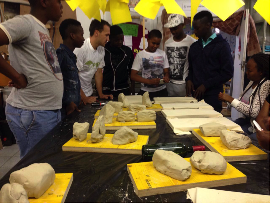 Siphelele testing the strength of a slab. Insights from this session included the advantages and drawbacks of cast and cured materials such as concrete, as well as more modular construction methods such as brick-builds and timber or steel frames.
