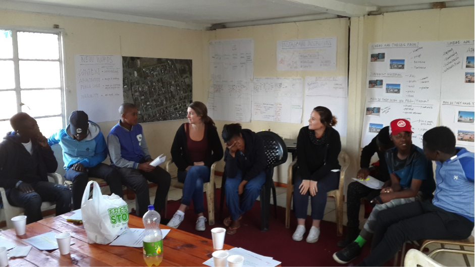 """Drawing upon all of the information received throughout the program, a """"Play the City"""" style game was tailor-made for the youth of Vukuzenzele. However, rather than centring around physical outputs on a board, the focus was on creating empathy and understanding for the various actors involved in infrastructure and housing provision, as well as the need for active personal involvement and co-operation in order to sustain a healthy and thriving community.."""