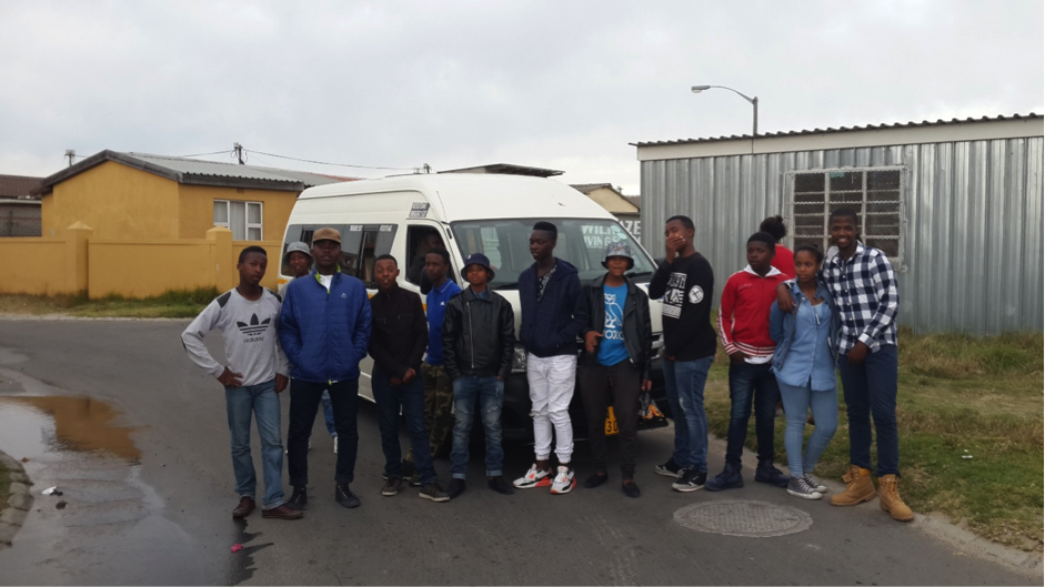 Some of the members of the Vukuzenzele youth do their best to look cool after a hot day on the trip! The tour included locations in Nyanga which were easily accessible and of high value to the community, a visualisation of the planned separation of Philippi from the city, and a journey along Main Road to see the transition from urban residential, to urban commercial and finally the CBD. The youth also enjoyed walking tours in Woodstock and Bo-Kaap, documenting their thoughts along the way.