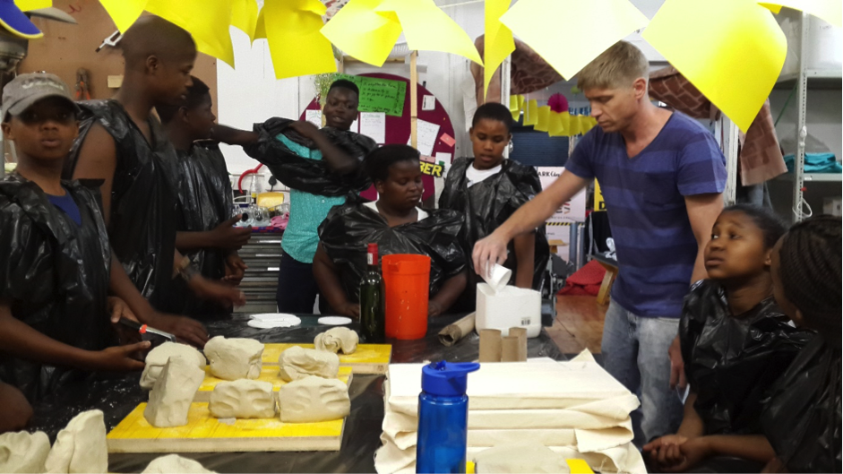 Here, a local Architect/Artist and guest facilitator – Heath Nash - leads a session which aims to explain construction and material properties through play with plaster of paris, wire, clay, toothpicks and polystyrene blocks.